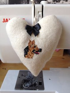 Fabric hanging heart hand embroidered with a German Shepherd on Etsy, £8.50