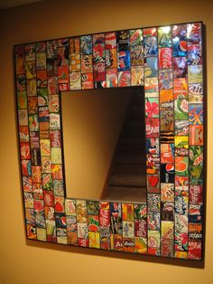 oooohhh! cool! pop cans, found art mirror - 145 cut up pop cans & 580 nails makes a beautiful mirror