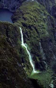 Water fall somewhere in New Zealand - anyone know the name of it and it's location?  Go to www.YourTravelVideos.com or just click on photo for home videos and much more on sites like this.