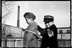 Playing as Ghetto Policeman, Lodz Poland 1943 - Henryk Ross