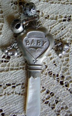 """Antique silver baby rattle. This rattle reminds me of the one from """"Nanny McPhee"""".. Which I absolutely love."""