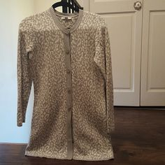 Long printed sweater Long sweater grey and white with matching buttons Perfect sweater neck for turtle neck or scarf Great for fall with jeans and boots No rips holes or stains Size states xs but could fit a small Isaac Mizrahi Sweaters
