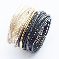18kt gold (1 coil) part oxidised silver grande spaghetti ring (25 coils)