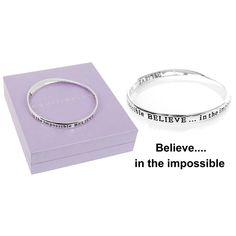 """A beautiful silver plated bangle with a special message inscribed on it  """"BELIEVE… in the impossible""""  The equilibrium jewellery makes a very special personal gift with a sentimental message ... a gift with meaning  The bangle comes in a beautiful padded gift box, and has a a slight twisted design, enabling the inscription to be seen from the inside out  Size: 1cm x 8cm"""