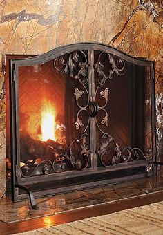 Our Toscana Fireplace Screen features beautifully hand-forged acanthus leaves that gracefully accent the screen.