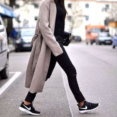 An All-Black Look Paired With a Duster Jacket and Black Sneakers