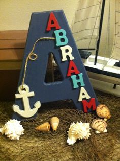 I could make this myself! Just have to see if his long name will fit! Custom Letter Boys name wood letter nursery nautical by DearEve, $26.00