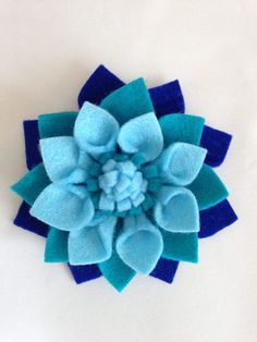 This a stunning three tone blue felt brooch. It measure 4x4 inches. It is available as a blue brooch or has a flower hair clip. Each petal has been hand drawn, hand cut, glued into the shape of a petal and then glued together to make the flower. It can be made in other colours if #feltflowers