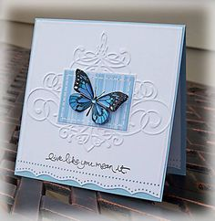 I love this blue, butterfly handmade valentine's day card with it's embossed background and paper piercing.  Stitching around the blue striped frame for the dimensional butterfly help add texture.