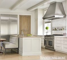 Interior design ideas photo gallery featuring understated kitchen with design by Phoebe Howard for a traditional and classic limestone manor home in Charlotte. Wormy chestnut wood pantry door and glossy white cabinetry mix beautifully. Interior Design Work, Beautiful Interior Design, Beautiful Interiors, Interior Ideas, Beautiful Kitchens, Beautiful Homes, Home Luxury, Barn Renovation, Traditional House