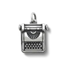 An iconic symbol for a writer, our sterling silver Vintage Typewriter Charm evokes a simpler time when thoughts were expressed one key at a time. #JamesAvery