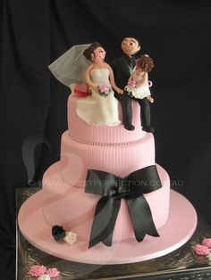 Pink textured wedding cake, with hand-made sugar figurine toppers. 2011.