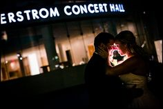 Joyful moment of the bride and groom taken outside the Segerstrom Center in Costa Mesa, CA