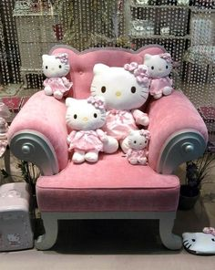 Hello Kitty and pink velvet chair!!! Bebe'!!! Love that pink!!!