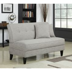 This fabric armless loveseat is luxuriously soft to the touch and would add a sleek, contemporary touch to your home decor. Featuring a comfortable button-tufted back and sturdy tapered wooden legs, this loveseat is great for city pads or condos.