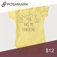 "Sunshine Bodysuit ""You are my sunshine!"" - You know you say it all the time! Well, this bodysuit is just as well-spoken as you! Plus, it's got this cool hipster feel to it!  Size & Fit  Reinforced three snap closure  Fits true to size  Fabric & Care  100% ring-spun cotton  Flatlock seams  Double-needle ribbed binding on all openings  Machine washable. Washing before first use is recommended  Color  Banana colored bodysuit with black lettering.  Consumer Product Safety Improvement Act (CPSIA)…"