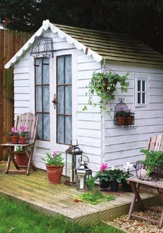 Adorable white garden shed, love the doors!