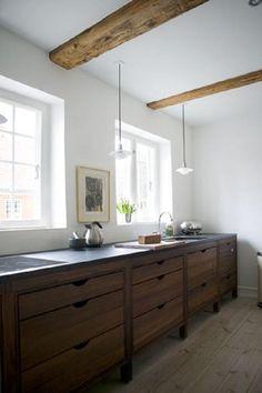 I love the drawers, no handles, wood, tall feet