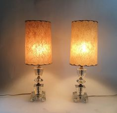 1950s Lamps Pair of mid-century modern lamps w clear glass base & tall drum shades.
