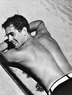 On the Beach: Maintaining a good tan is hard work.  Well maybe not for Tyrone Power, 1930s.