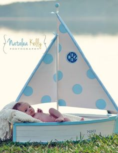 Preppy Newborn Pics Love how this sailboat we made for Cam's newborn pics turned out. Hand painted sails with polka dots and a monogram = PERFECTION!  www.stacybrowndesigns.com