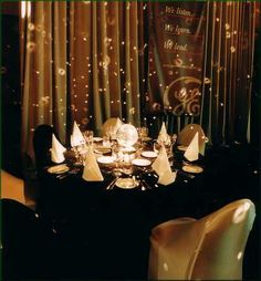 Black table cloths with black and gold chair covers