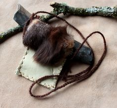 Fox fur and deerskin pouch by Lupa. At https://www.etsy.com/listing/212864074/reclaimed-deerskin-leather-pouch-with