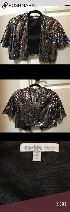 Sequin crop jacket Sparkly sequin, classic cut short jacket to top off a simple outfit to make it glam! Lined. Polishes off any outfit and perfect for holiday party in style! Bundle 3 items, save 10%! Family closet, not resells, so you are assured the highest quality and best care. So dazzling! Perfect to have in your closet for any special occasion! Tops off a simple outfit to make it completely couture. Charlotte Russe Jackets & Coats
