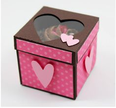 Valentine Ideas - This mini cupcake box is so cute and unique.  It will make a great gift box to put a bought or homemade cupcake in for valentines day.