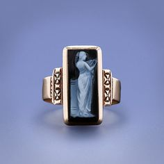 Victorian Cameo Ring. A darling and artsy antique ring in 10 karat rose gold featuring an elongated rectangular Sardonyx hardstone in black and white depicting an ethereal and lithesome muse. 5/8 inch long.