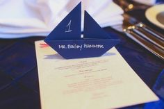 Sailboat place setting for a Nautical inspired wedding or Memorial Day wedding