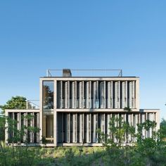 Amagansett+Dunes+House+by+Bates+Masi+Architects+is+shaded+with+strips+of+canvas