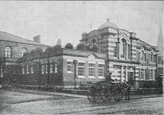 """Radcliffe Library on the Stand Lane site, formerly the site of a chapel and a newspaper.  The building, which is the one still in use in Stand Lane, occupies the original site of the first Bridge Wesleyan Chapel. When the new chapel was built in 1883, the old building was sold to the proprietors of the """"Radcliffe Express"""" weekly newspaper which ceased publication in 1901. This is the site that Adam Crompton Bealey bought and presented to the town for its new library."""