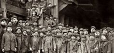 A group of boys who worked in a coal mine, posing outside the entrance of the mine. The photo was taken in 1911. Remember this photo whenever someone says labor law is an obstruction to freedom.