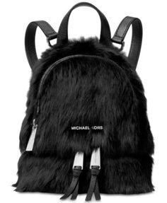 A flash of bright hardware truly shines on this Michael Michael Kors mini backpack that joins street-chic versatility with luxurious design in lavish, genuine fur. | Dyed, whole shaved shearling; fur