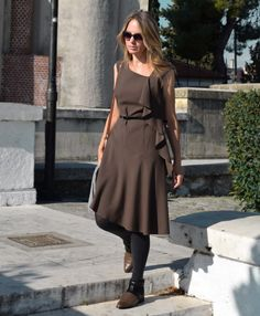 This elegant #fitandflare LILA #women's #dress designed with a spectacular side frill and finished with #asymmetrical fluid hem. It's perfect alone or above a blouse with tight sleeves. Where is a special mesh for the belt on the left side. Due to special cut and fluid soft fabric LILA dress fits perfectly to everyone. Crafted from Italian lightweight wool blend wrinkle-resistant fabric. Midi length.