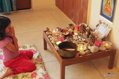Rashmie of Mommy Labs created what she calls a spiritual garden for herself and for her daughter to enjoy. To create her spiritual garden, she gathered rocks, pinecones, and other bits of nature she had collected over time - very much like a nature table. Place a cushion nearby and add some candles (optional, of course) and you've got a quiet place to meditate.