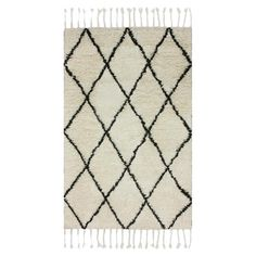 Showcasing a trellis motif and fringed edges, this wool rug adds a pop of pattern to your living room or entryway.   Product: Rug