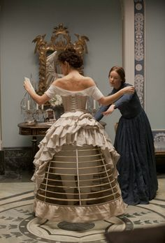 Anna Karenina being dressed, notice even in a moment of vulnerability she is caged and dismissive