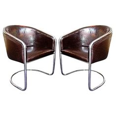 A Pair of Chrome and Patent Leather Tub Chairs by Thonet