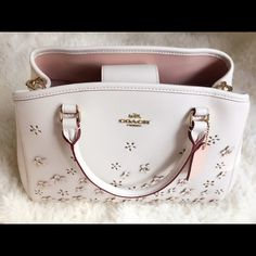 ❤️HP❤️Coach Satchel in Floral Rivets Leather/Beige This is a beautiful satchel in light beige color from the house of Coach! Brand new with tags! It features a removable & adjustable strap, a magnetic flap, three internal pockets, one zip pocket and four feet. Comes with a removable strap, coach bag charm, price tag, gift receipt, care booklet. Such a gorgeous everyday bag! It complements your eyes and every outfit in your wardrobe! Feel free to make a reasonable offer, lovelies! ❤️ Coach…