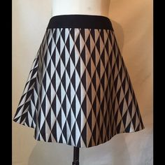 "Banana Republic skirt Black and silver diamond pattern on this Banana Republic skirt. Rayon, polyester and nylon. 17 1/2"" in length. Waist flat is about 14"". Banana Republic Skirts"