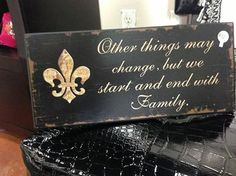 fleur de lis and family - THIS SITS ABOVE THE BIG TV