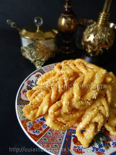 """For the July daring cooks challenge, Kouky from """"Cuisine à 4 mains"""",challenged us to make Griwech, a popular Algerian dessert that is a full flavoured delicacy that has both a melt-in-the-mouth and. Lebanese Recipes, French Food, Beignets, Macaroni And Cheese, Biscuits, Food And Drink, Appetizers, Snacks, Baking"""