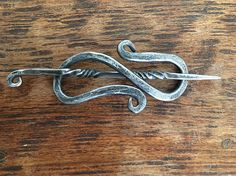 Hand Forged Celtic hair pin. Each one is made to order and can delivered in Silver or Black.