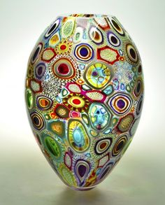 "by Michael Way Smith. Murrine glass piece - ""Arcobaleni Sole"".  I am currently intrigued by the limitless possibilities in using colour & pattern via cane & murrine. The process of consciously composing complex & intricate tessellating patterns in two dimensions, is like playing music: spectrum is like an octave, & colours are musical notes. Consciously arranged in a harmonious composition, beautiful music for the eyes can arise in glass via the interplay of light with pattern, colour and…"
