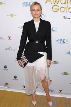 Diane Kruger.. Theory AW 2014 outfit, comprised of a black belted jacket and white asymmetric skirt..... - Celebrity Fashion Trends