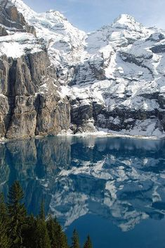 Oeschinensee, Berner Oberland, Switzerland Beautiful mountians circling the lake.