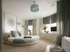 I think I would have done some of the design differently, but I love the basic concept of the round bed in the round room.