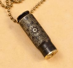 "Time capsule necklace - ""Starburst Medallion"" etched bullet casing pendant - bullet jewelry. $30.00, via Etsy."